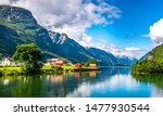 Amazing nature view with fjord and mountains. Beautiful reflection. Location: Scandinavian Mountains, Norway. Artistic picture. Beauty world. The feeling of complete freedom - stock photo