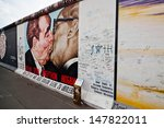 BERLIN - APRIL 19: political wall art on the Berlin Wall on April 19, 2012 in Berlin. The picture on the wall shows the brother's kiss between Erich Honecker and Leonid Breshnew. - stock photo