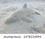 Sand Sculpture Of A Dolphin On...