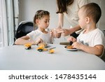 mother with children drinking... | Shutterstock . vector #1478435144