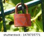 Red Lock At The Fence With...