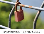 Red Padlock On Fence With...