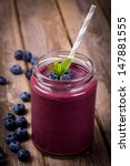 blueberry smoothie in a glass... | Shutterstock . vector #147881555