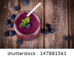 blueberry smoothie in a glass... | Shutterstock . vector #147881561
