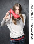 girl holding a red shoe | Shutterstock . vector #147897449