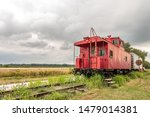 Shiny Red Caboose Parked On Th...