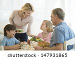 happy mother serving food to... | Shutterstock . vector #147931865