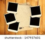 old photos on wooden board | Shutterstock . vector #147937601
