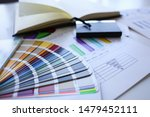 Small photo of Color print of pantone statistics offset organization gives customer an order products for distribution during promotion concept