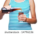 Girl Pouring a Bottle of Soda into a Glass isolated over white - stock photo