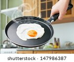 fried egg in a frying pan on a... | Shutterstock . vector #147986387