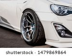silvery alloy wheels. racing white car. drift, sports car. extreme sport - stock photo