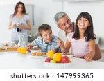 Smiling Family Eating Breakfas...