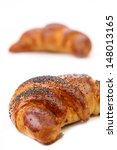 Appetizing croissants with poppy. - stock photo