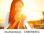 Asian Woman Drinking Coffee In...