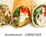 Wrap sandwiches containing chicken and cheese. - stock photo