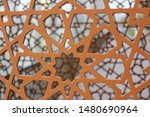 Arabesque pattern on a steel structure with brown paint. This traditional Islamic pattern or design features linear patterns of interlacing lines, usually combined with other elements or motifs.