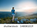 girl hiking on peak of mountain  | Shutterstock . vector #148081019