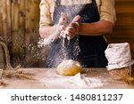 Small photo of Women's hands, flour and dough. Levitation in a frame of dough and flour. A woman in an apron is preparing dough for home baking. Rustic style photo. Wooden table, wheat ears and flou.Emotional photo