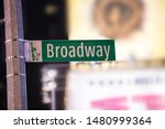 Road Sign And Broadway Avenue...