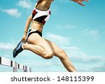 female hurdle runner leaping... | Shutterstock . vector #148115399
