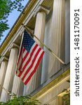 Facade Flag Robert F Kennedy Justice Department Building Pennsylvania Avenue Washington DC Completed in 1935. Houses 1000s of lawyers working at Justice.