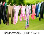 Stock photo clothes hanging on line in garden 148146611