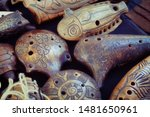 Small photo of Ocarina, whistle - wind musical instrument, kind of whistle vascular flute. There are earthenware, porcelain and wooden ocarinas