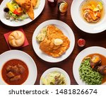 Austrian Food, Schnitzel - Top shot of delicious austrian meals beautifully arangend on a wooden table