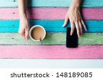 hand holding coffee cup and... | Shutterstock . vector #148189085