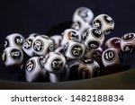 Stock photo black and white lottery balls in a bingo machine lottery balls in a sphere in motion gambling 1482188834
