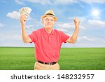 Happy Senior Man Holding Money...
