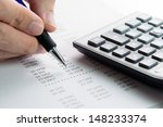 analyzing finance report with... | Shutterstock . vector #148233374