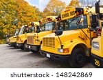 Row of yellow school buses...