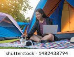Stock photo camping and tent vacation concept asian women adventure travelers hiking sitting and play laptop 1482438794