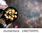 Stock photo snails baked with sauce baked snails with butter and spice 1482704591