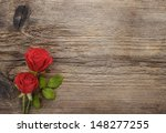 Red Roses On Wooden Table....