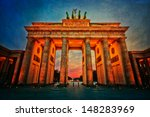 the Brandenburg Gate in Berlin, Germany, with blue night sky and processed with a creative grunge texture - stock photo