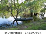 the old boat near the tree that ... | Shutterstock . vector #148297934