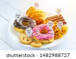 Small photo of Calories counting and food control concept. doughnut ,croissant ,chocolate and cookies with label of quantity of calories for Calories measuring