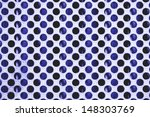 Close up of metal plate hole pattern - stock photo