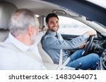 Father and son sitting in car, driving and talking. - stock photo