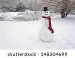 Snowman Standing In Winter...