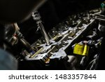 an engineer who repairs an... | Shutterstock . vector #1483357844