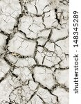 Dry cracked earth in areas with arid climate - stock photo