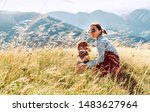 Stock photo smiling female hugs her beagle dog resting as they walking in mountains together 1483627964
