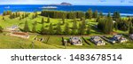 Small photo of Norfolk Island, South Pacific, Australia. Norfolk Island golf course lined with norfolk island pines. In the foreground are buildimgs from the convict period of the 1820's.