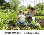 Mother And Son Gardening...