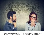 Small photo of anxious bashful woman looking at a handsome man both exchanging with each other with many thoughts