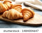 Board With Tasty Croissants On...